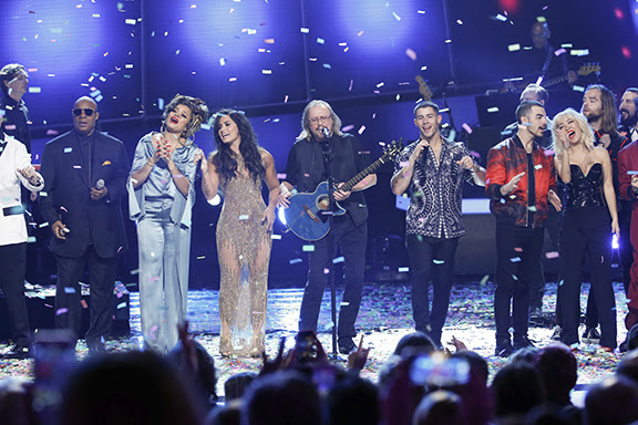 Stevie Wonder, Andra Day, Demi Lovato, Barry Gibb, Nick Jonas, and DNCE are seen on stage during STAYIN' ALIVE: A GRAMMY® SALUTE TO THE MUSIC OF THE BEE GEES, scheduled to broadcast on the CBS Television Network.Photo: Monty Brinton/CBS ©2017 CBS Broadcasting, Inc. All Rights Reserved